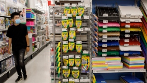 A man shops for back to school supplies in a shop in Toronto, Thursday, Aug. 18, 2021. THE CANADIAN PRESS/Cole Burston