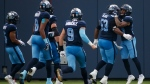 Toronto Argonauts' D.J. Foster (29) and Toronto Argonauts offensive lineman Philip Blake (53) celebrate a touchdown during first half CFL football action against the Winnipeg Blue Bombers, in Toronto, Saturday, Aug. 21, 2021. THE CANADIAN PRESS/Cole Burston