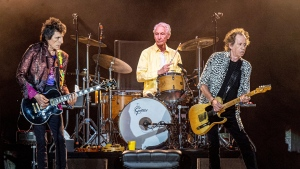 Ronnie Wood, from left, Charlie Watts and Keith Richards of The Rolling Stones perform on  July 15, 2019, in New Orleans. Watts' publicist, Bernard Doherty, said Watts passed away peacefully in a London hospital surrounded by his family on Tuesday, Aug. 24, 2021. He was 80.  (Photo by Amy Harris/Invision/AP, File)