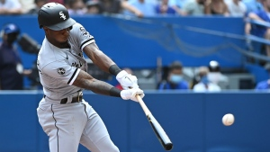 Chicago White Sox's Luis Robert hits a two run home run, scoring Tim Anderson in the third inning of an American League MLB baseball game against the Toronto Blue Jays in Toronto on Thursday, Aug. 26, 2021. THE CANADIAN PRESS/Jon Blacker