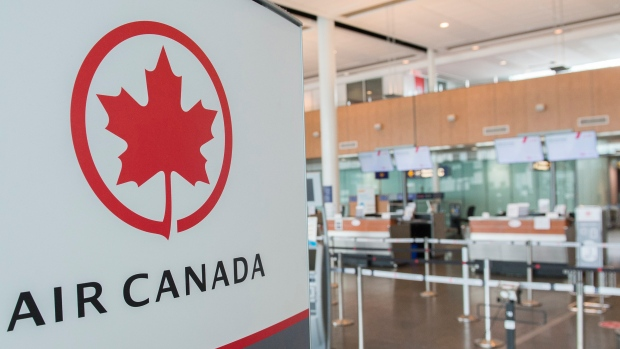 An Air Canada check-in area is shown at Montreal-Pierre Elliott Trudeau International Airport, Saturday, May 16, 2020. THE CANADIAN PRESS/Graham Hughes
