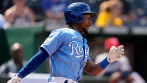 Kansas City Royals' Jarrod Dyson watches his two-run single during the ninth inning of a baseball game against the Minnesota Twins Sunday, July 4, 2021, in Kansas City, Mo. The Twins won 6-2. (AP Photo/Charlie Riedel)