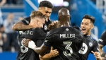 CF Montreal players celebrate a goal by Samuel Piette (not shown) against Toronto FC during first half MLS soccer action in Montreal, Friday, August 27, 2021. THE CANADIAN PRESS/Graham Hughe