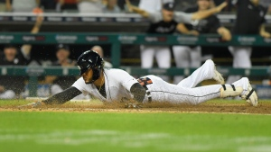 Detroit Tigers pinch hitter Victor Reyes slides home after hitting an inside-the-park home run against the Toronto Blue Jays in the eighth inning of a baseball game, Friday, Aug. 27, 2021, in Detroit. (AP Photo/Jose Juarez)