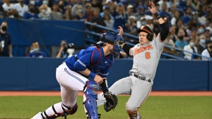 Baltimore Orioles' Ryan Mountcastle (6) slides safely into home ahead of a tag by Toronto Blue Jays' catcher Danny Jansen in the sixth inning of an American League baseball game in Toronto on Tuesday, Aug. 31, 2021. THE CANADIAN PRESS/Jon Blacker