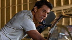 """This image released by Paramount Pictures shows Tom Cruise portraying Capt. Pete """"Maverick"""" Mitchell in a scene from """"Top Gun: Maverick."""" Paramount Pictures on Wednesday postponed the release of the film, sending another of the fall's top movies out of 2021 due to the rise in coronavirus cases and the delta variant. Instead of opening Nov. 19, the """"Top Gun"""" sequel, starring Tom Cruise, will instead debut Memorial Day weekend next year, on May 27. (Scott Garfield/Paramount Pictures via AP)"""
