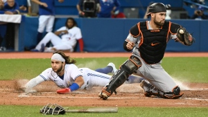 Toronto Blue Jays' Bo Bichette, left, slides safely into home ahead of a tag by Baltimore Orioles catcher Austin Wynns on a single by Blue Jays' Teoscar Hernandez in the fourth inning of an American League baseball game in Toronto on Wednesday, Sept. 1, 2021. THE CANADIAN PRESS/Jon Blacker