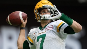Edmonton Elks quarterback Trevor Harris warms up before a CFL football game against the B.C. Lions in Vancouver, on Thursday August 19, 2021. THE CANADIAN PRESS/Darryl Dyck