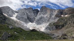 A view of the Petit Vignemale glacier, left, and the Oulettes, right, on the Vignemale massif's north face in the Pyrenean mountain range, as seen from the Gaube valley in southern France, Sunday, Aug. 3, 2020. Spanish scientists say Europe's southernmost glaciers will likely be reduced to ice patches in the next two decades due to climate change. The study also found that the shrinking of ice mass on the Pyrenees mountain range is continuing at the steady but rapid speed seen at least since the 1980s. (AP Photo/Aritz Parra)