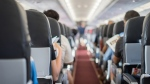 People sit in an airliner's cabin in an undated file image from a Thai passenger plane. (Adobe Stock)
