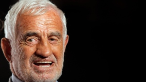 In this Oct. 14, 2013 file photo, French actor Jean-Paul Belmondo arrives at the opening ceremony of the 5th edition of the Lumiere Festival, in Lyon, central France. French New Wave actor Jean-Paul Belmondo has died, according to his lawyer's office on Monday Sept. 6, 2021. (AP Photo/Laurent Cipriani, File)