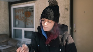 Shelby Curtis smokes a cannabis at her home in Regina on Thursday Nov. 12, 2020. Curtis says she uses marijuana to help her cope with anxiety and depression. THE CANADIAN PRESS/Michael Bell