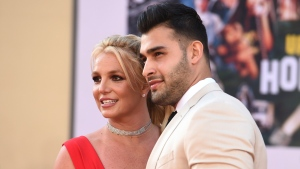 """Britney Spears and Sam Asghari arrive at the Los Angeles premiere of """"Once Upon a Time in Hollywood,"""" at the TCL Chinese Theatre, Monday, July 22, 2019. Spears announced on Instagram on Sunday, Sept. 12, 2021, that she and Asghari are engaged. The couple met on the set of her """"Slumber Party"""" music video in 2016. (Photo by Jordan Strauss/Invision/AP, File)"""