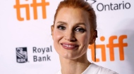"""Jessica Chastain, star of """"The Eyes of Tammy Faye,"""" poses at the premiere of the film at the 2021 Toronto International Film Festival, Sunday, Sept. 12, 2021, in Toronto. (AP Photo/Chris Pizzello)"""
