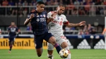 FC Cincinnati forward Brenner, left, and Toronto FC defender Auro fight for the ball during the first half of an MLS soccer match Saturday, Sept. 11, 2021, in Cincinnati. (AP Photo/Jeff Dean)