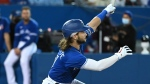 Toronto Blue Jays' Bo Bichette watches his solo home run in the fifth baseball game against the Tampa Bay Rays in Toronto on Monday, Sept. 13, 2021. THE CANADIAN PRESS/Jon Blacker