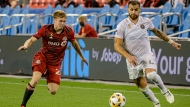 Inter Miami defender Leandro Gonzalez (6) is defended by Toronto FC forward Jacob Shaffelburg (24) during second half MLS action in Toronto, on Tuesday, September 14, 2021. THE CANADIAN PRESS/Christopher Katsarov