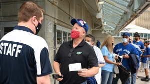 Toronto Blue Jays fans show either proof of being double-vaccinated or a negative COVID-19 test prior to entering Rogers Centre before an American League baseball game between the Toronto Blue Jays and the Tampa Bay Rays in Toronto on Monday, Sept. 13, 2021. THE CANADIAN PRESS/Jon Blacker