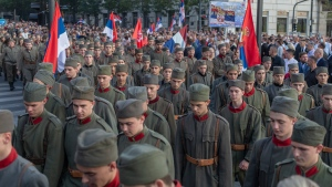 """Actors dressed in Serbian WWI military uniform replicas during a ceremony to mark the newly established """"Day of Serb Unity, Freedom and the National Flag"""" state holiday in Belgrade, Serbia, Wednesday, Sept. 15, 2021. Serbia has kicked off a new holiday celebrating national unity with a display of military power, triggering unease among its neighbors. (AP Photo/Marko Drobnjakovic)"""