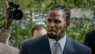 FILE - This photo from Friday May 9, 2008, shows R. Kelly arriving for the first day of jury selection in his child pornography trial at the Cook County Criminal Courthouse in Chicago. On Wednesday, Sept. 15, 2021, prosecutors in Kelly's sex trafficking trial at Brooklyn Federal Court in New York, played video and audio recordings for the jury they say back up allegations he abused women and girls. (AP Photo/Charles Rex Arbogast, File)