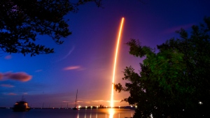The launch of a SpaceX Crew Dragon capsule atop a Falcon 9 rocket is seen after taking off from Pad 39A at Kennedy Space Center in Cape Canaveral, Fla., late Wednesday, Sept. 15, 2021, with an all-amateur crew. The launch is viewed here from north of the Beachline with the Canaveral Lock in the foreground. (Florida Today via AP)
