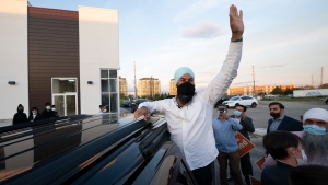NDP Leader Jagmeet Singh greets supporters during a campaign stop in Brampton, Ont. Wednesday, September 15, 2021. THE CANADIAN PRESS/Jonathan Hayward
