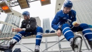 Toronto Maple Leafs Auston Matthews (left) and Mitch Marner tape their shinpads before the team's outdoor practice at Nathan Phillips Square in front of City Hall in Toronto on Thursday February 7, 2019. THE CANADIAN PRESS/Frank Gunn