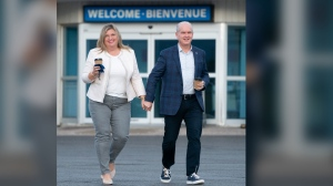 Conservative leader Erin O'Toole and his wife Rebecca O'Toole walk towards their campaign plane Wednesday, September 15, 2021 in Ottawa. THE CANADIAN PRESS/Adrian Wyld