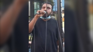 Samuel Nithiananthan, 32, of Toronto, is shown in this photo. He is one of eight suspects wanted in connection with a violent protest outside 14 Division in July. (Toronto Police Service)