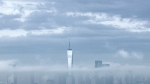 The One World Trade Center tower peeps out from a layer of fog enveloping the lower Manhattan skyline as seen from Jersey City, New Jersey on Thursday, June 11, 2020. (AP Photo/Wong Maye-E)