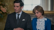 """This image released by Netflix shows Josh O'Connor, left, and Emma Corrin in a scene from """"The Crown."""" O'Connor and Corrin are considered frontrunners for Emmy awards for lead actor and actress in a drama series for their portrayals of ill-fated royal mates Charles and Diana. (Des Willie/Netflix via AP)"""