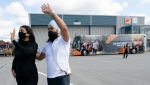 NDP Leader Jagmeet Singh and his wife Gurkiran Kaur wave as they leave Sherbrooke, Que., Friday, Sept. 17, 2021. THE CANADIAN PRESS/Jonathan Hayward