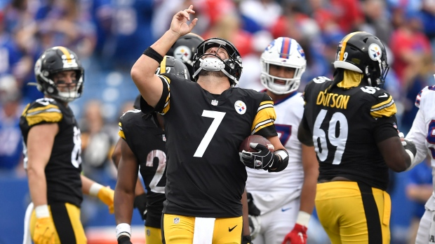 Pittsburgh Steelers quarterback Ben Roethlisberger (7) begins to celebrate as time runs out in a 23-16 Steelers win over the Buffalo Bills in an NFL football game in Orchard Park, N.Y., Sunday, Sept. 12, 2021. (AP Photo/Adrian Kraus)