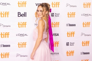 """Lily-Rose Depp walks the red carpet as she promotes the film """"Wolf"""" during the Toronto International Film Festival, on Friday, September 17, 2021. THE CANADIAN PRESS/Chris Young"""