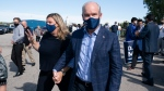 Conservative Leader Erin O'Toole and Rebecca O'Toole Rebecca leave a campaign stop in Flamborough, Ont., Saturday, Sept. 18, 2021. THE CANADIAN PRESS/Adrian Wyld