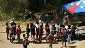 Haitian migrants line up for water after crossing into the United States from Mexico, Friday, Sept. 17, 2021, in Del Rio, Texas. Thousands of Haitian migrants have assembled under and around a bridge in Del Rio presenting the Biden administration with a fresh and immediate challenge as it tries to manage large numbers of asylum-seekers who have been reaching U.S. soil. (AP Photo/Eric Gay)