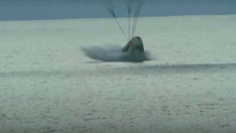 In this image taken from video a SpaceX capsule carrying four people splashes down in the Atlantic off the Florida coast, Saturday, Sept. 18, 2021. The all-amateur crew was the first to circle the world without a professional astronaut. (Inspiration4 via AP)