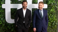 """Director Kenneth Branagh, right, and actor Jamie Dornan walk the red carpet as they promote the film """"Belfast"""" during the Toronto International Film Festival, in Toronto, Sunday, Sept. 12, 2021. THE CANADIAN PRESS/Chris Young"""