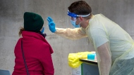 A swab is taken at a pop-up COVID-19 testing site on the Dalhousie University campus in Halifax on Wednesday, Nov. 25, 2020. THE CANADIAN PRESS/Andrew Vaughan