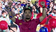 In this photo provided by the Manny Pacquiao MediaComms, Senator Manny Pacquiao raises his hands during a national convention of his PDP-Laban party in Quezon city, Philippines on Sunday Sept. 19, 2021. Philippine boxing icon and senator Manny Pacquiao says he will run for president in the 2022 elections. (Manny Pacquiao MediaComms via AP)