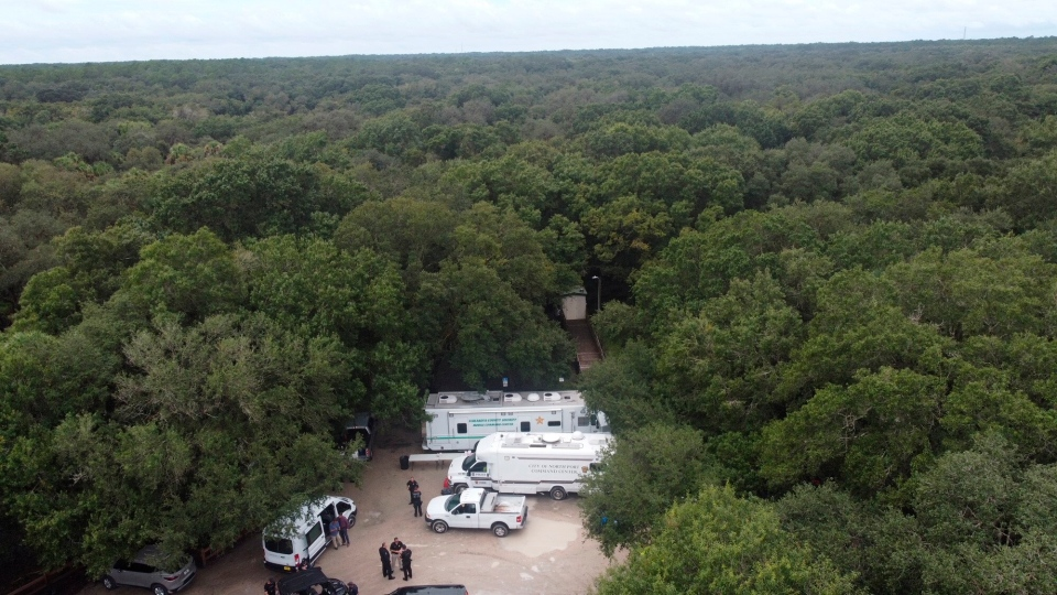 """In this photo provided by North Port Police Department, law enforcement officials conduct a search of the vast Carlton Reserve in the Sarasota, Fla., area for Brian Laundrie on Saturday, Sept. 18, 2021. Laundrie is a person of interest in the disappearance of his girlfriend, Gabrielle """"Gabby"""" Petito. (North Port Police Department via AP)"""