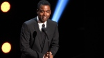 """FILE - In this March 30, 2019 file photo, Chris Rock presents the award for outstanding comedy series at the 50th annual NAACP Image Awards at the Dolby Theatre in Los Angeles. Chris Rock on Sunday, Sept. 19, 2021 said he has been diagnosed with COVID-19 and sent a message to anyone still on the fence: """"Get vaccinated."""" (Photo by Chris Pizzello/Invision/AP, File)"""