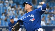 Toronto Blue Jays' Hyun Jin Ryu pitches in the first inning of an American League baseball game against the Minnesota Twins in Toronto on Friday, Sept. 17, 2021. THE CANADIAN PRESS/Jon Blacker