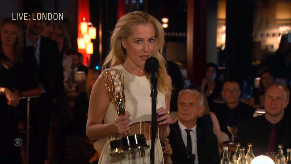 """In this video grab issued Sunday, Sept. 19, 2021, by the Television Academy, Gillian Anderson accepts the award for outstanding supporting actress in a drama series for """"The Crown"""" during the Primetime Emmy Awards. (Television Academy via AP)"""