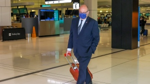 """France's Ambassador to Australia Jean-Pierre Thebault arrives at Sydney Airport, Saturday, Sept. 18, 2021. Thebault has described as a """"huge mistake"""" Australia's surprise cancellation of a major submarine contract in favor of a U.S. deal, in an unprecedented show of anger among the allies. (AP Photo/David Gray)"""