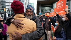 NDP Leader Jagmeet Singh is hugged by a supporter as he arrives in downtown Vancouver, B.C., Monday, Sept. 20, 2021. THE CANADIAN PRESS/Jonathan Hayward