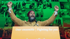 NDP Leader Jagmeet Singh hams it up as he does a walk through of the election night stage setup in Vancouver, B.C., Monday, Sept. 20, 2021. THE CANADIAN PRESS/Jonathan Hayward