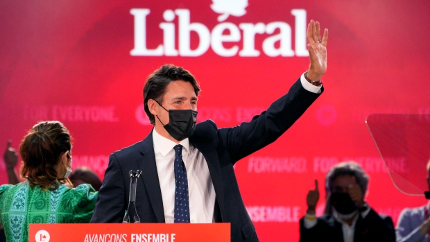 Liberal Leader Justin Trudeau greets supporters prior to his victory speech at Party campaign headquarters in Montreal, early Tuesday, Sept. 21, 2021. THE CANADIAN PRESS/Paul Chiasson