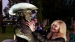 Actress Loni Anderson touches a memorial sculpture of her former husband, the late actor Burt Reynolds, at an unveiling ceremony at Hollywood Forever Cemetery, Monday, Sept. 20, 2021, in Los Angeles. Reynolds died in 2018 at the age of 82. (AP Photo/Chris Pizzello)