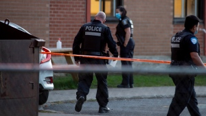 Several people are being treated for injuries after a driver lost control of their vehicle, striking people at a polling station set up at Sunshine Academy school in the West Island community of Dollard-Des Ormeaux, Montreal, Monday, Sept. 20, 2021. THE CANADIAN PRESS/Peter McCabe